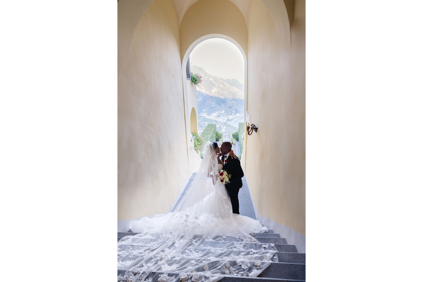 sandra aberg sony alpha 7r3 view from above of a brides couple kissing in stairs in front of a mountains