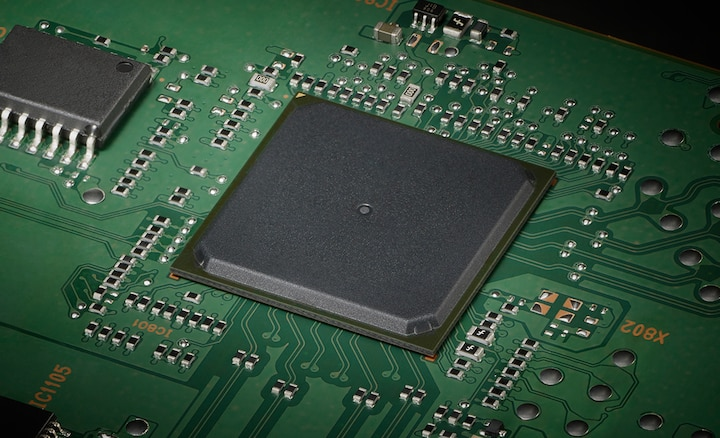 Close-up of circuit board showing FPGA processor.