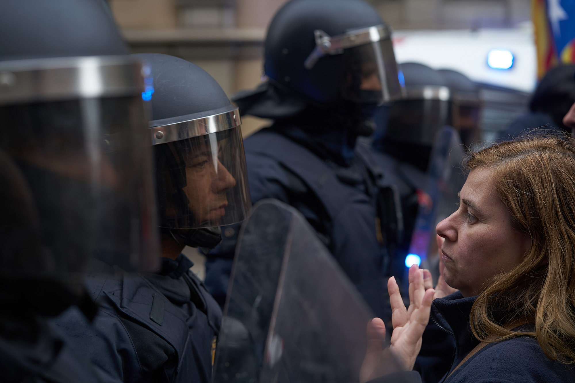 samuel aranda sony alpha 7RII protester squares up to a policeman during catalan unrest