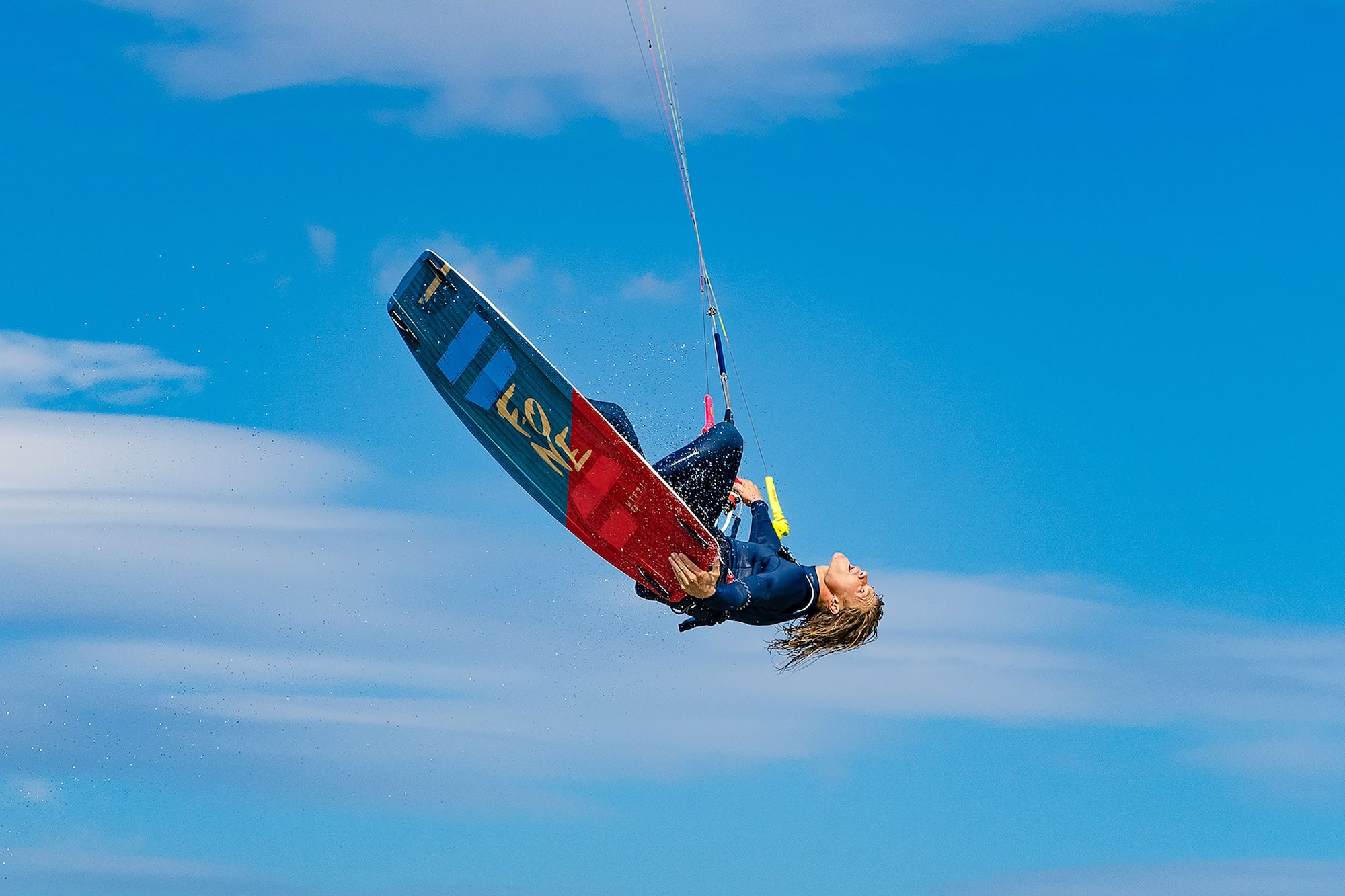 danas macijauskas sony alpha 7III kite surfer hanging upside down in mid air with a brilliant blue sky behind