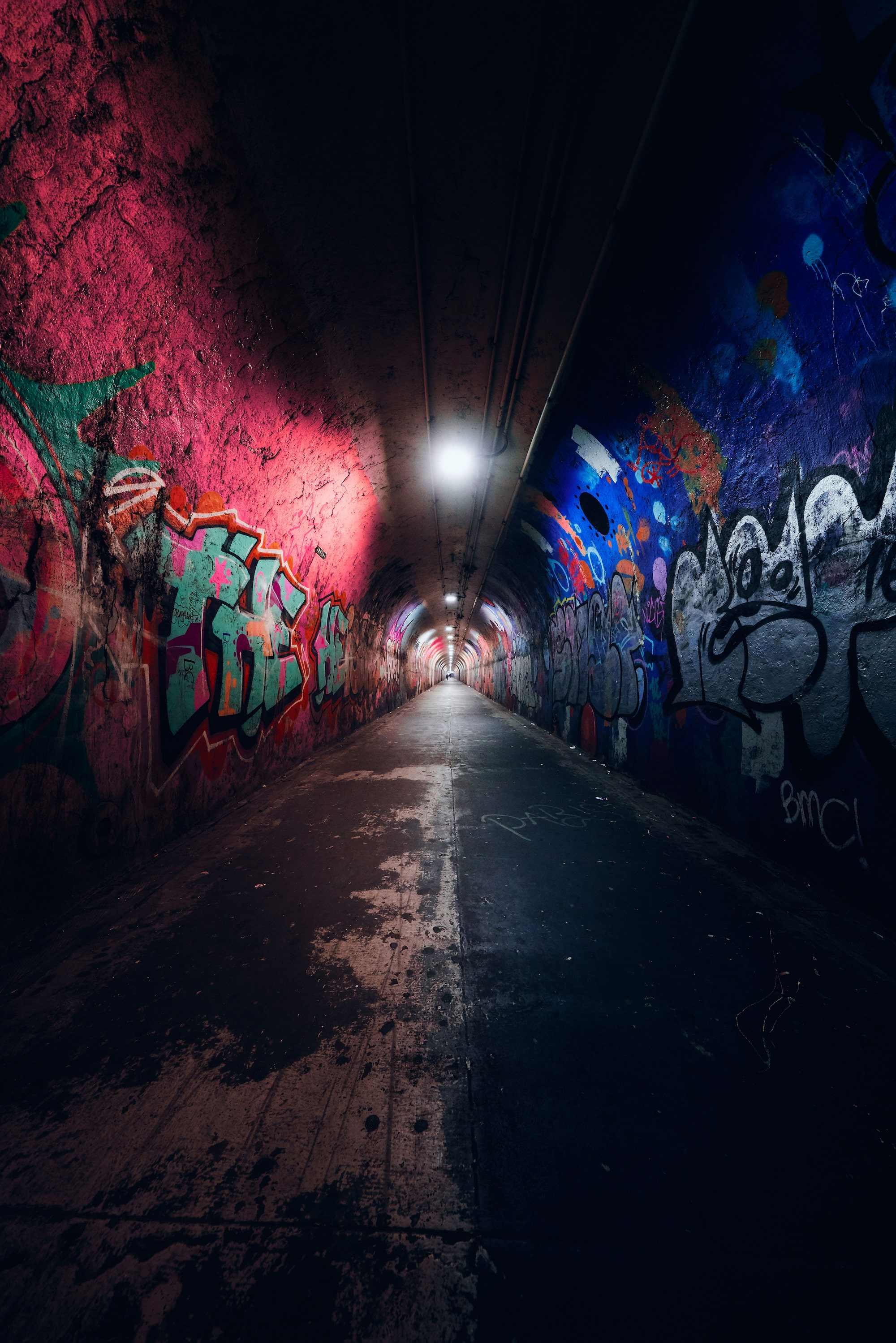 Ron Timehin sony alpha 7RM3 a gloomy tunnel in new york with graffiti on the walls