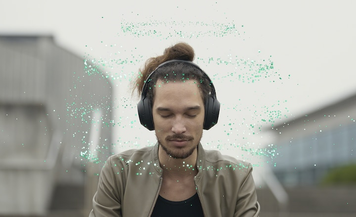 Man listening to music in 360 Reality Audio