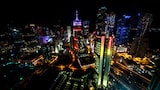 alex-farinelli-sony-alpha-9-cityscape-at-night-with-neon-coloured-buildings