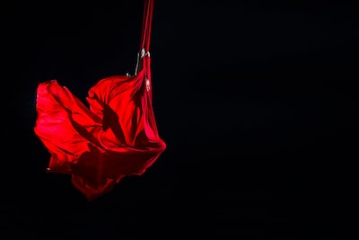 jose m mercado sony alpha 99 lady -draped in red cloth hangs from a trapeze