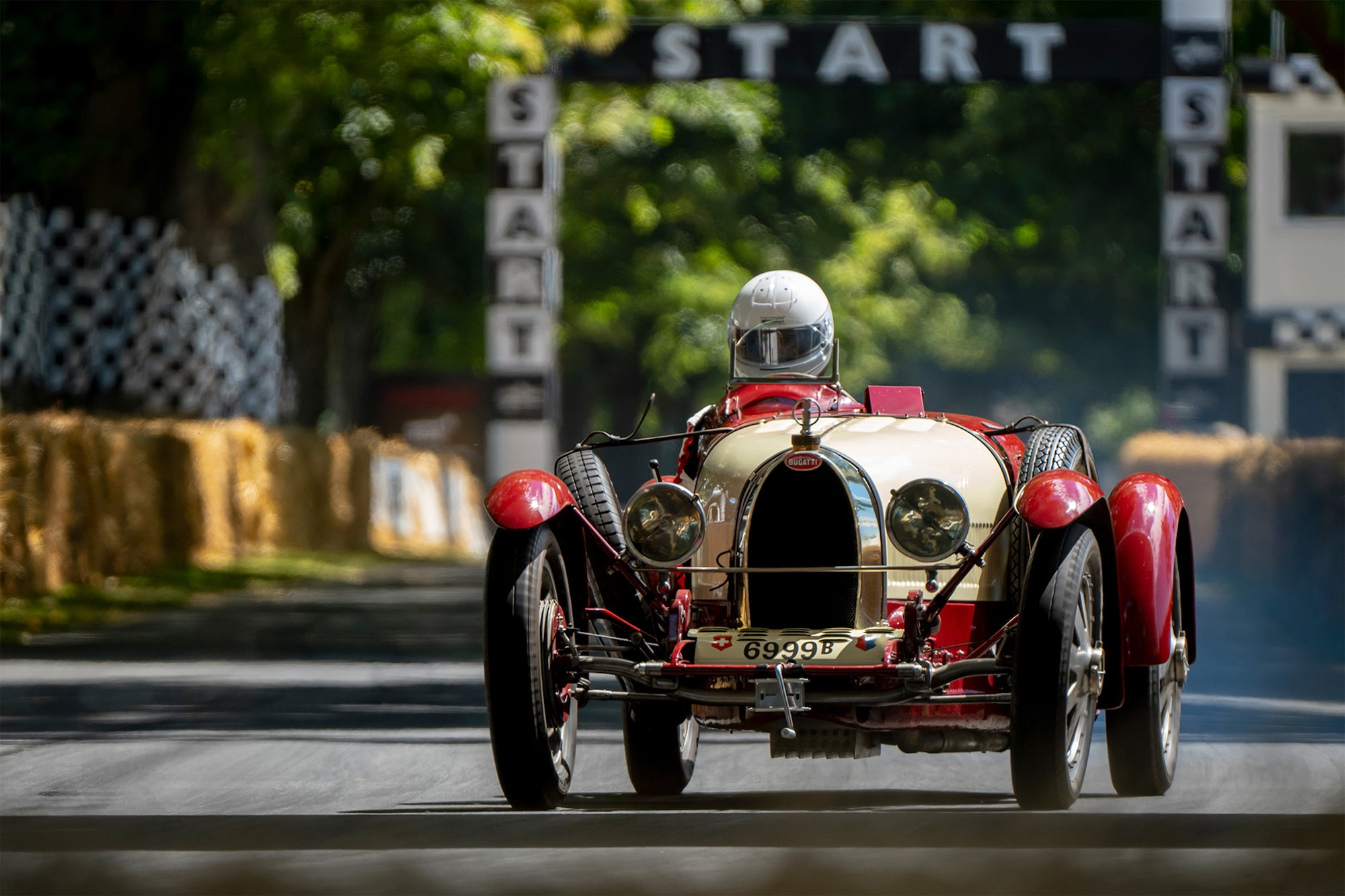 dominic fraser sony alpha 6400 old bugatti racing car being driven along a leafy road