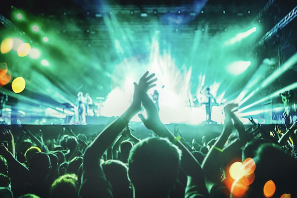 Image of people dancing at a live concert.