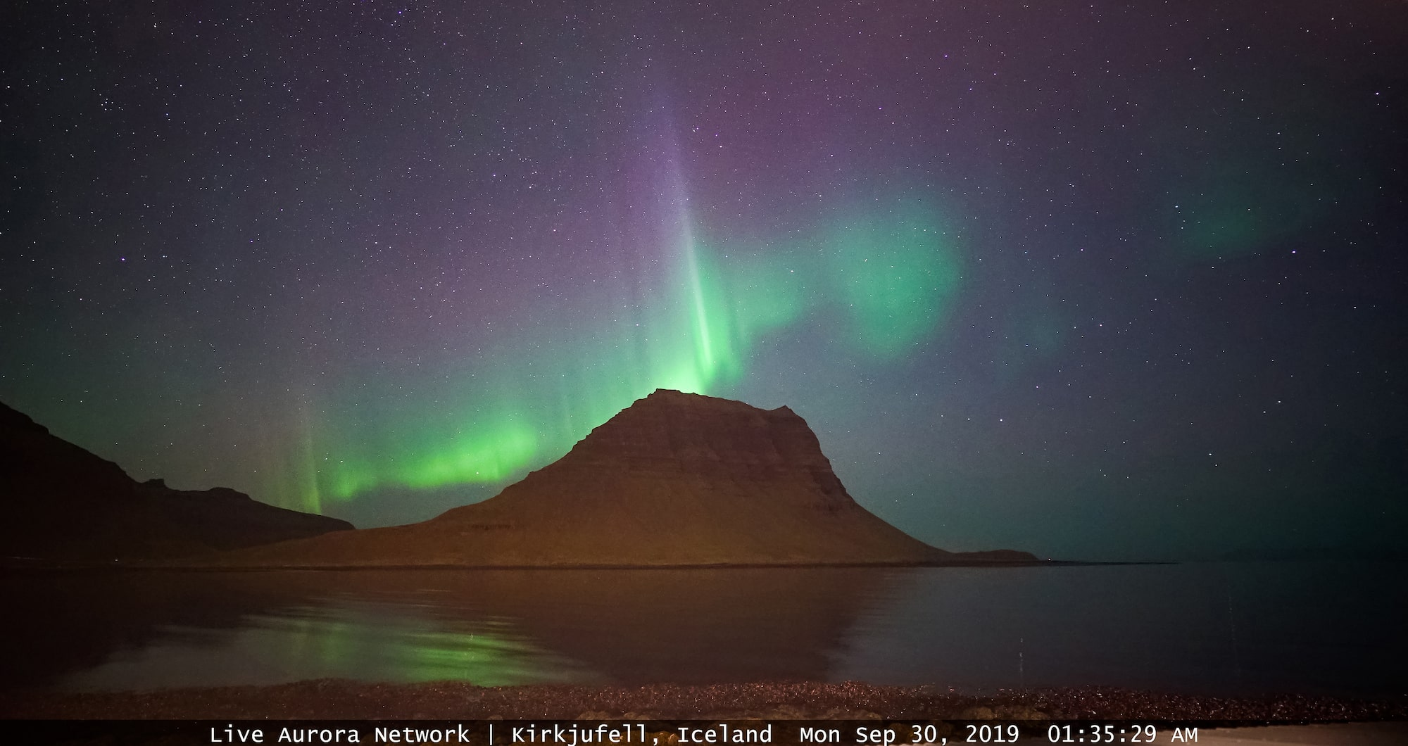 steve collins sony alpha 7SII feed from live aurora network shows a soft green light over a mountain