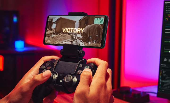Person gaming on Xperia 5 III using dualshock controller
