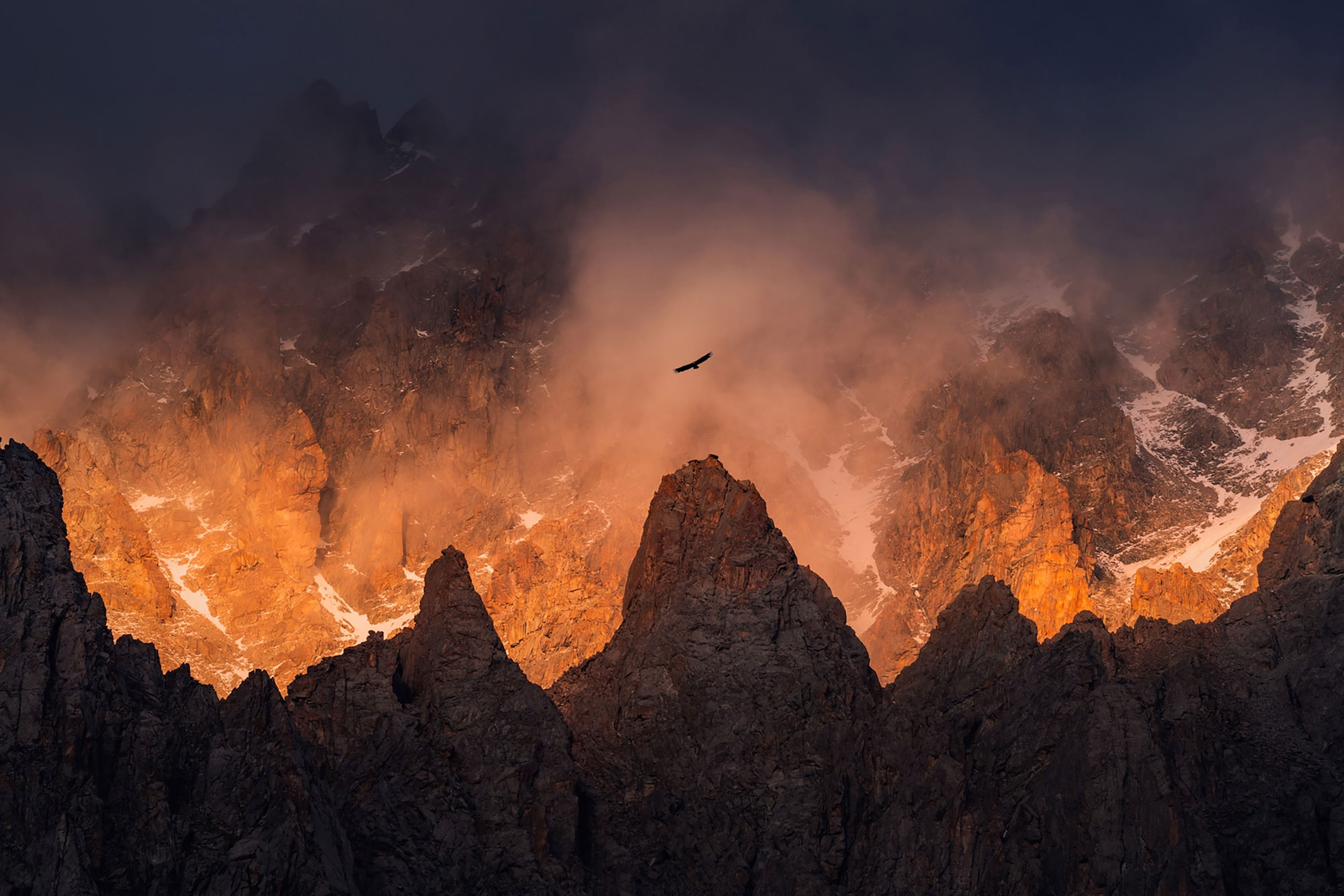 albert dros sony alpha 7RIII an eagle soars above volcanic mountains illuminated in fiery orange