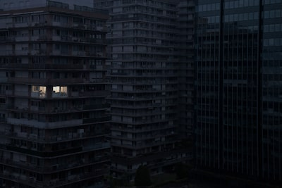 julien mauve sony alpha 7RII dark and moody apartment block with just one light showing