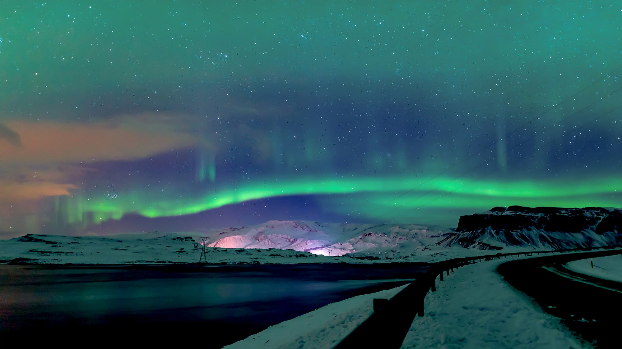 steve collins sony alpha 7SII dancing aurora display over distant mountains and snow covered roads
