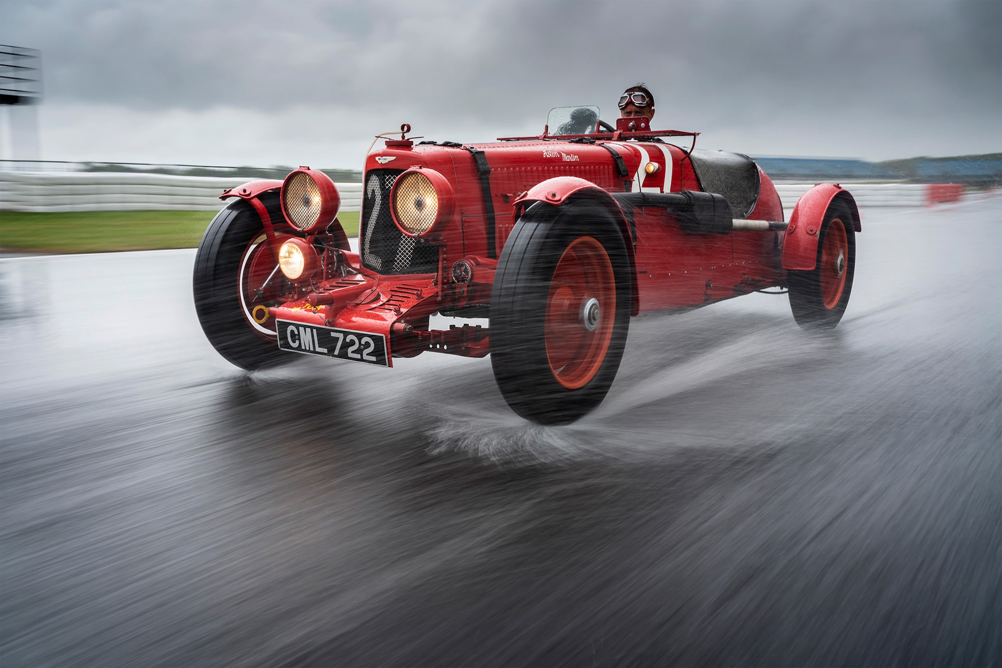 dominic fraser sony alpha 7RIII old aston martin racing car being driven at speed through the rain